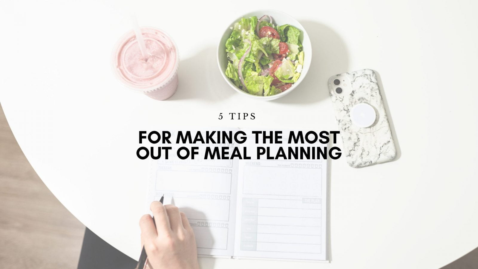 image showing a woman writing in a journal to depict meal planning